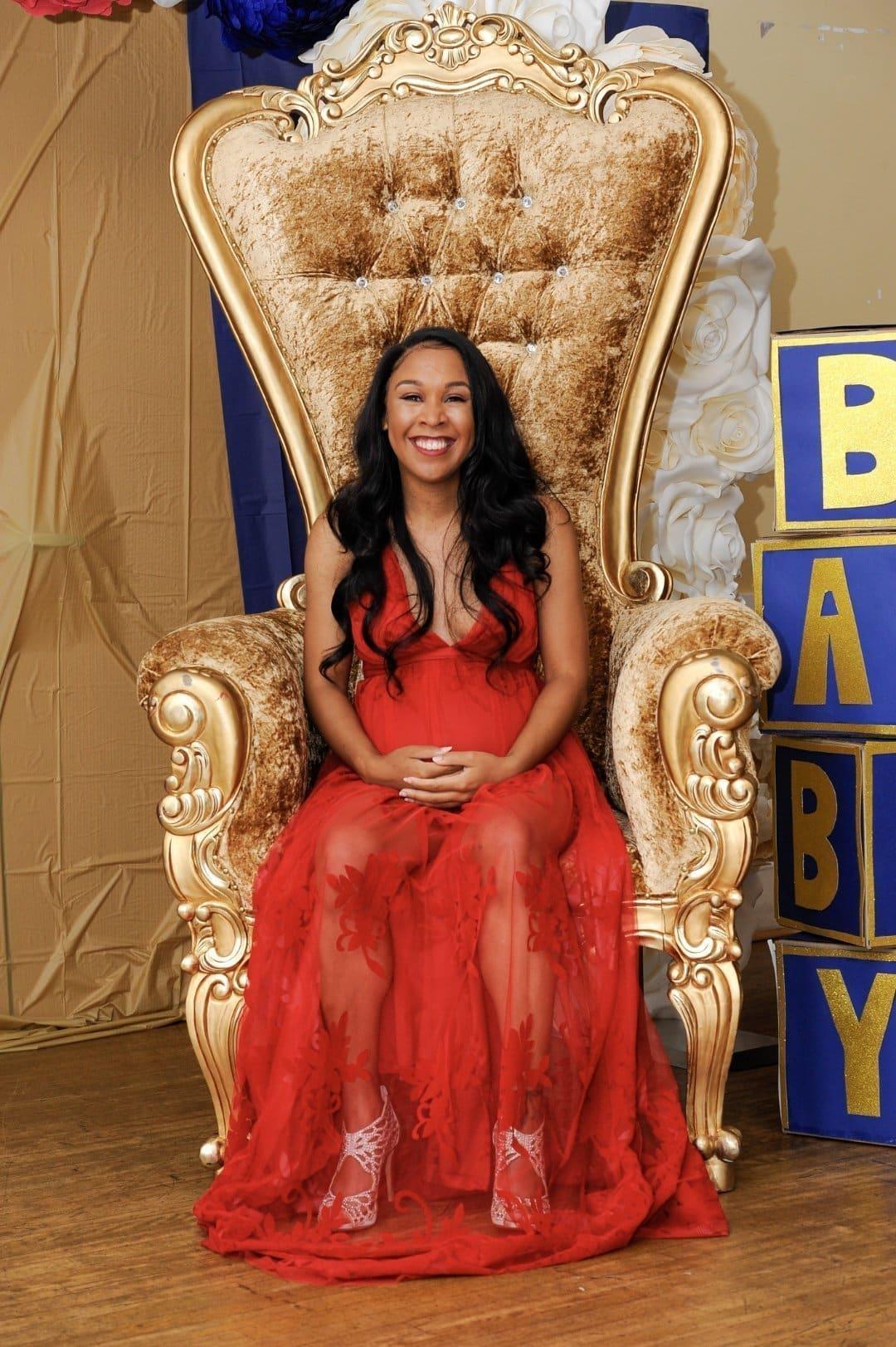 Iesha of LivingLesh wearing a red baby shower dress