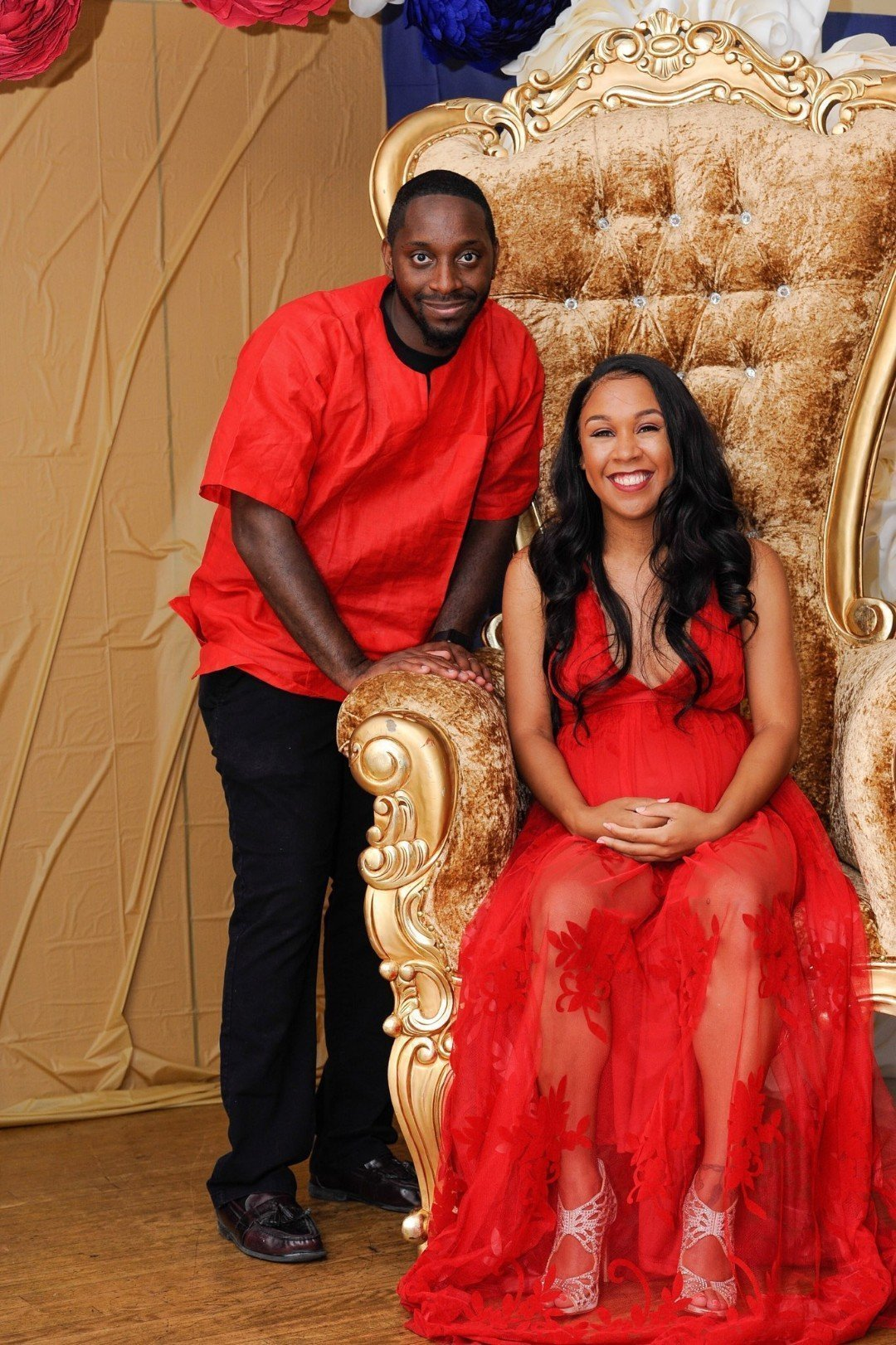 Iesha of LivingLesh and her husband in her baby shower throne chair