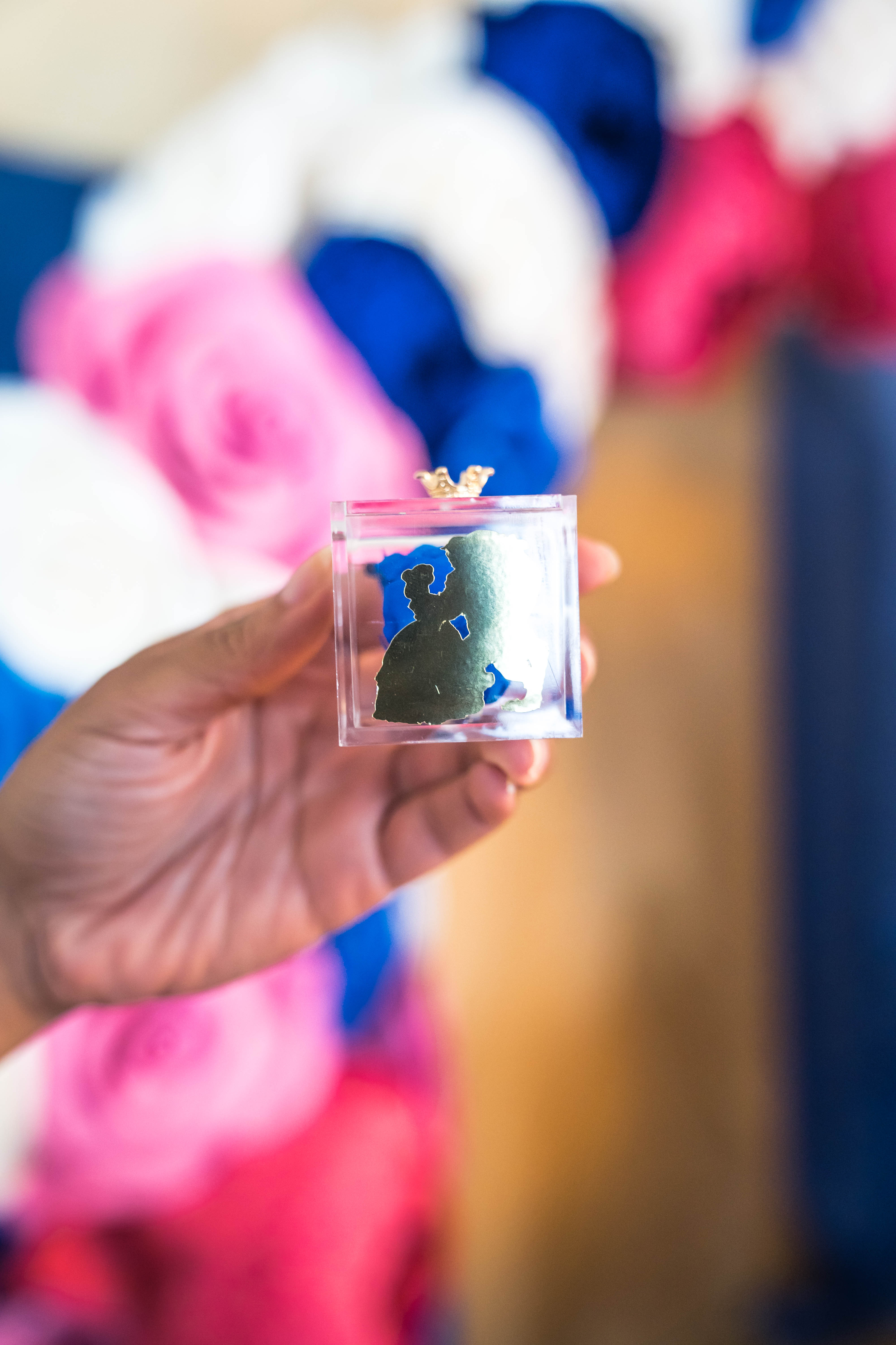 Iesha of LivingLesh showing beauty and the beast party favors