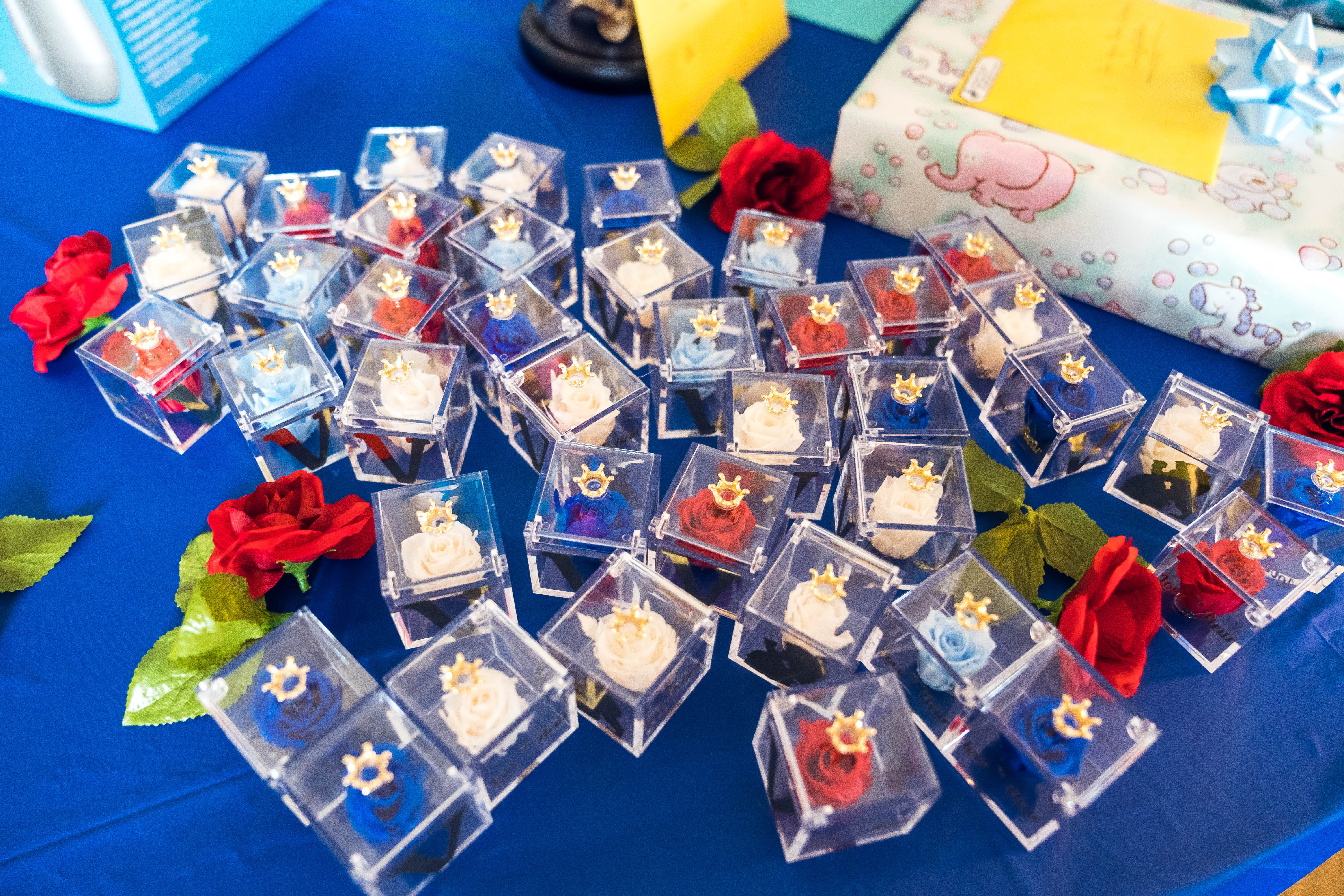 Iesha of LivingLesh sharing single rose party favors for beauty and the beast baby shower