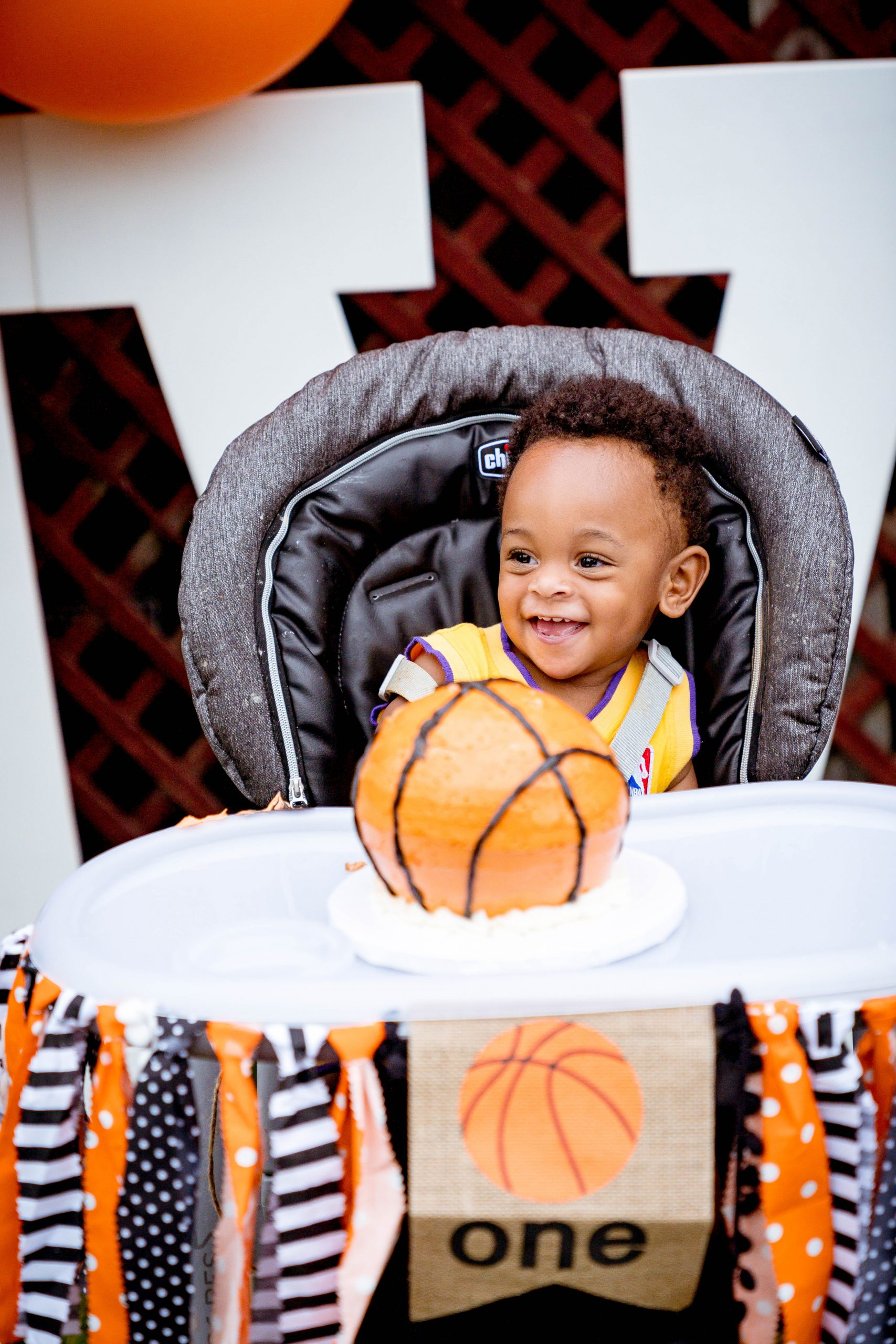 livinglesh basketball birthday party smash cake in high chair